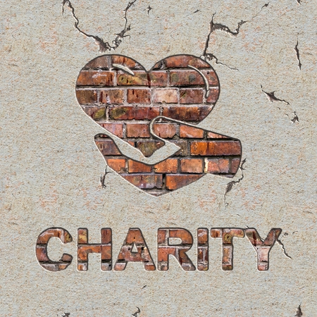 Charity Word and Icon of Heart in the Hand on the Brick Wall.