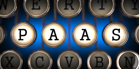 deployment: PAAS - Platform-as-a-Service - on Old Typewriters Keys on Blue Background. Stock Photo