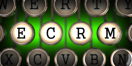 ecrm: ECRM on Old Typewriters Keys on Green Background. Stock Photo