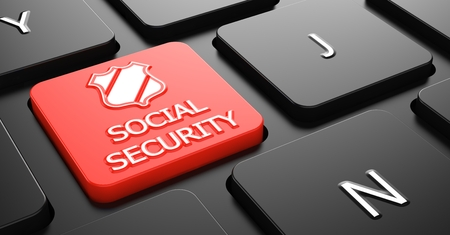 Social Security with Shield Icon - Red Button on Black Computer Keyboard. photo