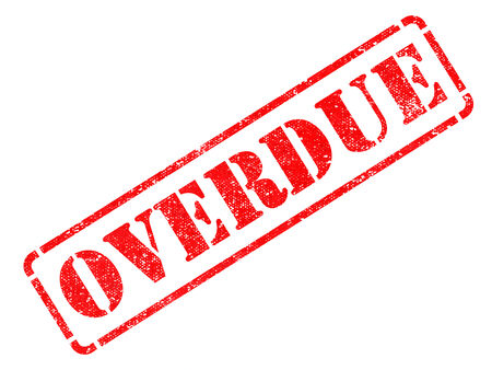 overdue: Overdue - Inscription on Red Rubber Stamp Isolated on White.