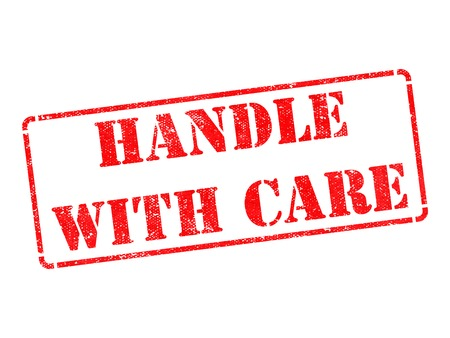 Handle with Care - Inscription on Red Rubber Stamp Isolated on White. photo