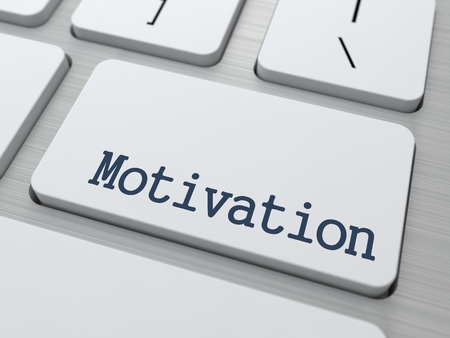 prompting: Motivation - Button of Modern White Computer Keyboard.