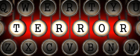 cyberwarfare: Terror on Old Typewriters Keys on Blue Background. Stock Photo