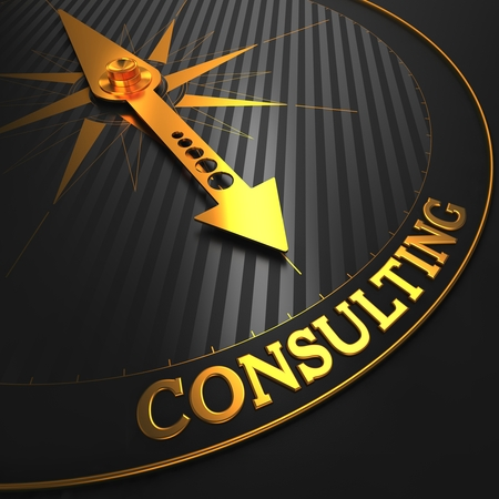 Consulting - Golden Compass Needle on a Black Field Pointing. photo