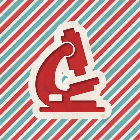 Microscope Icon on Red and Blue Striped Background. Vintage Concept in Flat Design. photo