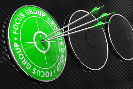 focus group: Focus Group Concept. Three Arrows Hitting the Center of Green Target on Black Background. Stock Photo