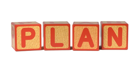 Plan on Wooden Childrens Alphabet Block Isolated on White. photo