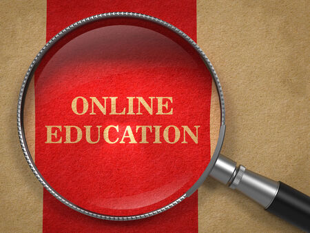 Online Education concept. Magnifying Glass on Old Paper with Red Vertical Line Background. photo