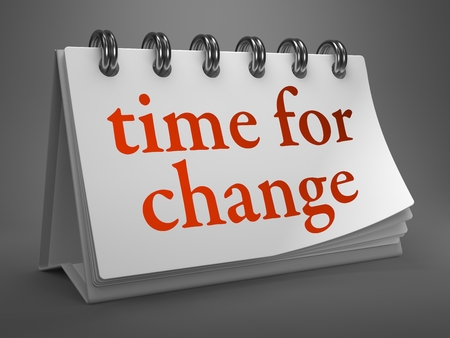 Time for Change - Red Word on White Desktop Calendar Isolated on Gray Background. photo