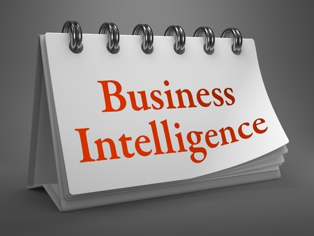 Business Intelligence - Red Words on White Desktop Calendar Isolated on Gray Background. photo