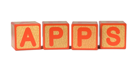 Apps on Colored Wooden Childrens Alphabet Block Isolated on White. photo