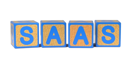 SAAS on Colored Wooden Childrens Alphabet Block Isolated on White. photo