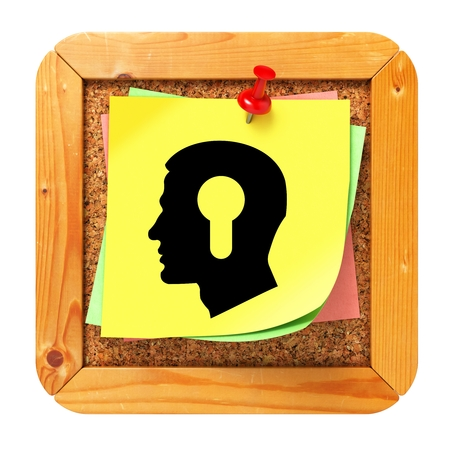 Psychological Concept - Profile of Head with a Keyhole Icon on Yellow Sticker on Cork Message Board. photo