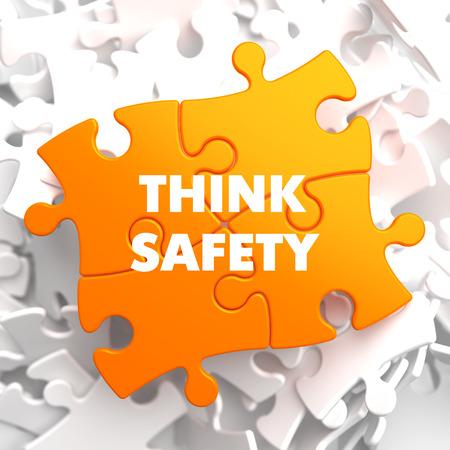 think safety: Think Safety on Orange Puzzle on White Background.