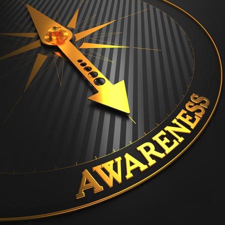 Awareness Concept - Golden Compass Naald op een zwart gebied Wijzen.