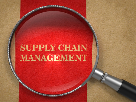 Supply Chain Management Concept. Text on Old Paper with Red Vertical Line Background through Magnifying Glass. Stock Photo