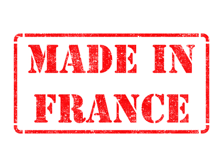Made in France - inscription on Red Rubber Stamp Isolated on White. photo