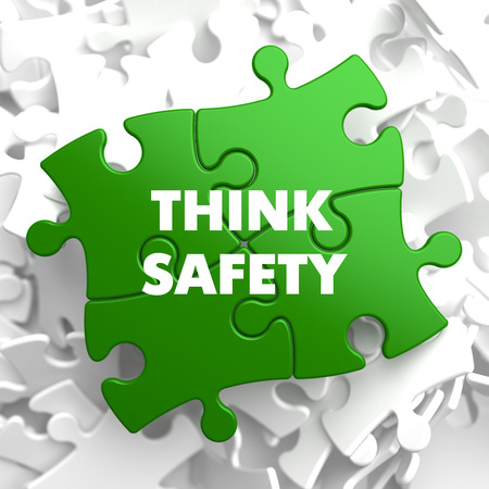 think safety: Think Safety on Green Puzzle on White Background.