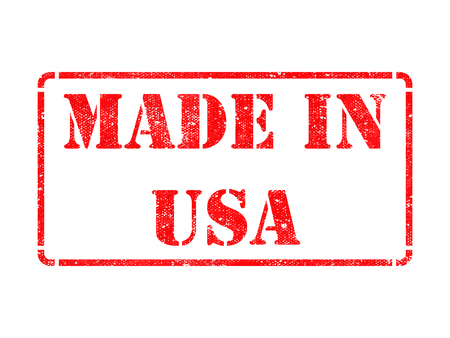 Made in USA - inscription on Red Rubber Stamp Isolated on White. photo