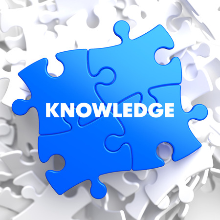 Knowledge on Blue Puzzle on White . Stock Photo