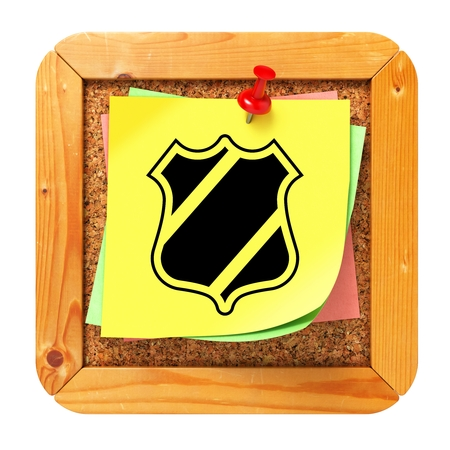 baffle: Security Concept with Shield Icon on Yellow Sticker on Cork Message Board. Stock Photo
