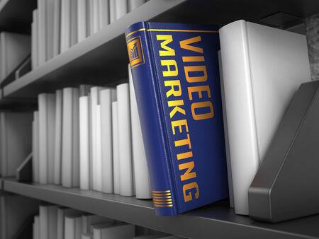 Video Marketing - Dark Blue Book on the Black Bookshelf between white ones. Internet Concept. photo