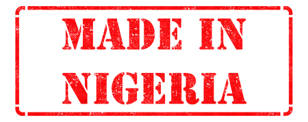 transnational: Made in Nigeria - inscription on Red Rubber Stamp Isolated on White  Stock Photo