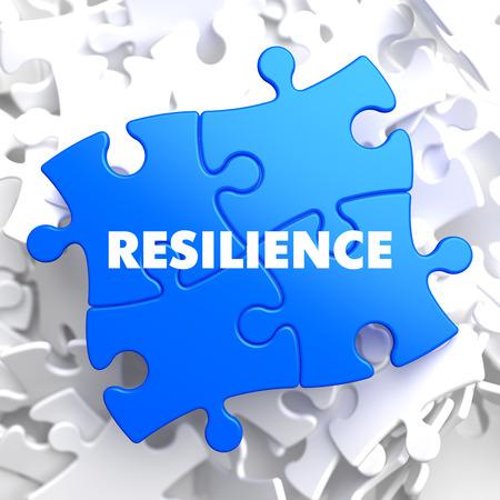Veerkracht op Blue puzzel op witte achtergrond Stockfoto