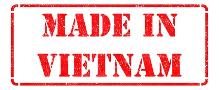 Made in Vietnam - inscription on Red Rubber Stamp Isolated on White  photo