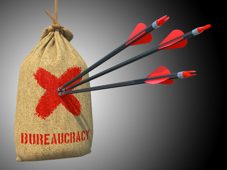 bureaucratism: Bureaucracy - Three Arrows Hit in Red Mark Target on a Hanging Sack on Grey Background