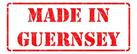 Made in Guernsey - inscription on Red Rubber Stamp Isolated on White  photo