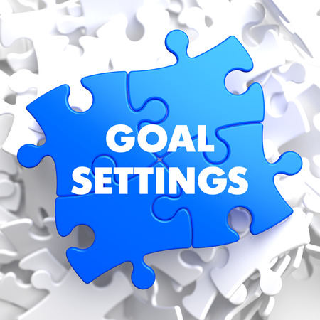 reachable: Goal Settings on Blue Puzzle on White Background  Stock Photo