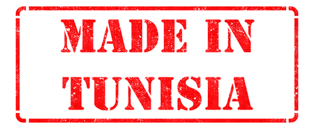 Made in Tunisia - inscription on Red Rubber Stamp Isolated on White. photo