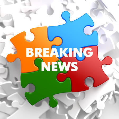 Breaking News on Multicolor Puzzle on White Background.