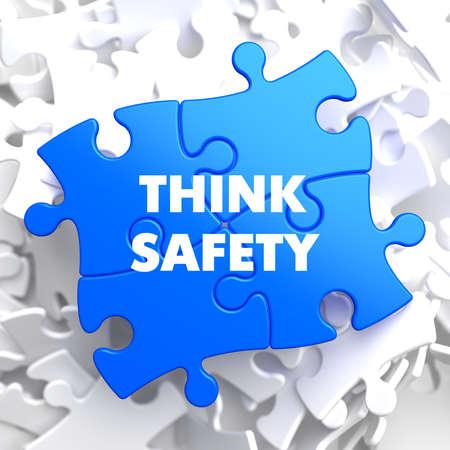 think safety: Think Safety on Blue Puzzle on White Background. Stock Photo