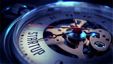 entrepreneurship: Startup on Pocket Watch Face with Close View of Watch Mechanism. Time Concept. Vintage Effect.