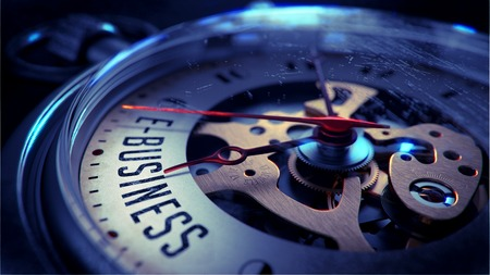 E-Business on Pocket Watch Face with Close View of Watch Mechanism. Time Concept. Vintage Effect.