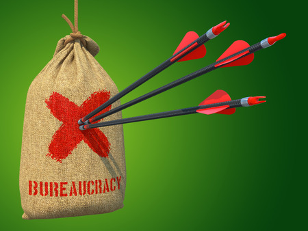 Bureaucracy - Three Arrows Hit in Red Target on a Hanging Sack on Green Bokeh Background.