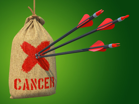 fighting cancer: Cancer - Three Arrows Hit in Red Mark Target on a Hanging Sack on Grey Background. Stock Photo