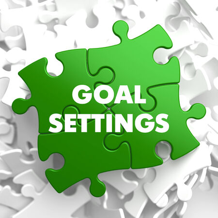 Goal Settings on Green Puzzle on White Background. photo