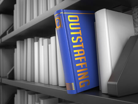 minimization: Outstaffing  - Blue Book on the Black Bookshelf between white ones. Internet  Concept. Stock Photo