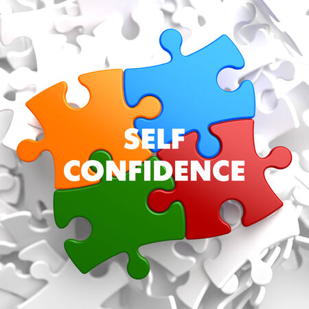 Self Confidence on Multicolor Puzzle on White Background. photo