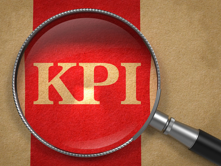 KPI. Magnifying Glass on Old Paper with Red Vertical Line. photo