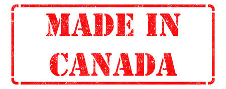 Made in Canada - inscription on Red Rubber Stamp Isolated on White. photo