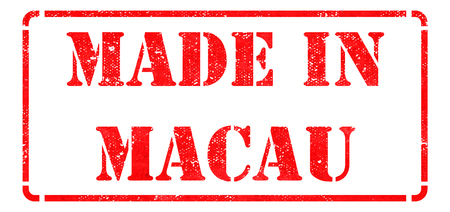 Made in Macau - inscription on Red Rubber Stamp Isolated on White. photo