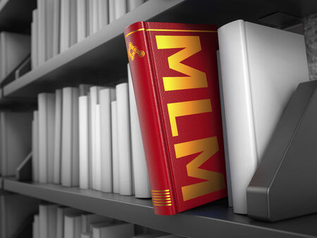 MLM - Red Book on the Black Bookshelf between white ones. photo