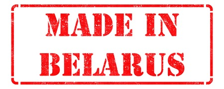 Made in Belarus - inscription on Red Rubber Stamp Isolated on White. photo
