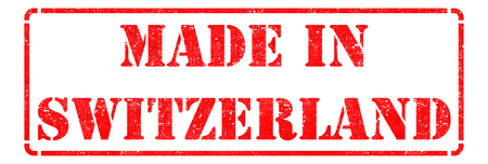 Made in Switzerland- inscription on Red Rubber Stamp Isolated on White. photo