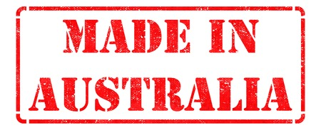 Made in Australia - inscription on Red Rubber Stamp Isolated on White. photo